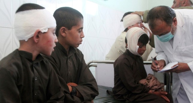 Injured boys receive treatment in a hospital after a car bomb attack in Ghazni province, central Afghanistan, Sunday, July 7, 2019. (AP Photo)