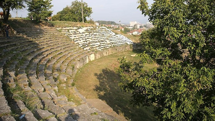 The ancient theater includes a semicircular seating area known as the ,40 Steps.,