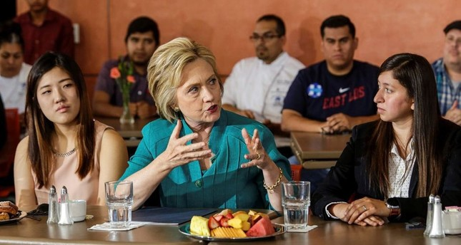 Democratic presidential candidate Hillary Clinton C holds a conversation on immigration.