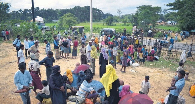 People fleeing as a result of the renewal of violence against the Muslim Rohingya minority of Myanmar. Bangladesh is blocking the entry of desperate Rohingya refugees.