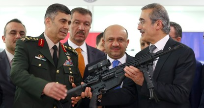 In a small city east of the capital Ankara, the country's defense minister joined workers in overalls and commanders of the army yesterday for a small-scale ceremony that was actually for a...
