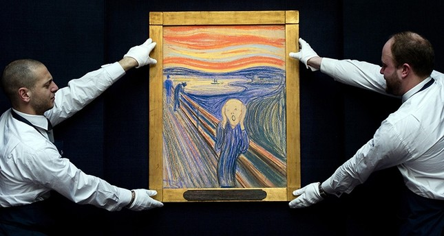 This April 12, 2012 file photo shows Sotheby's employees posing with Norwegian artist Edvard Munch's 1895 pastel on board version of 'The Scream' at Sotheby's auction house in central London (AFP Photo)