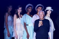 Italian labels Versus Versace and Emporio Armani brought the darkness and light to London Fashion Week on Sunday, burnishing the city's reputation as a fashion capital.  Industry icon Giorgio...