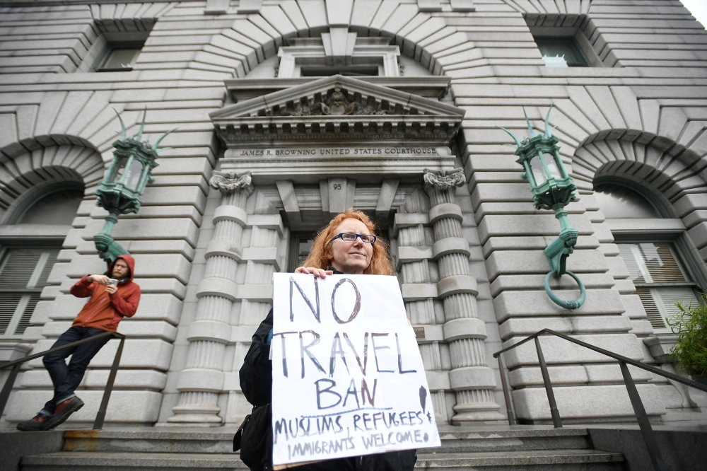 Author Beth Kohn protests against the travel ban, outside the 9th U.S. Circuit Court of Appeals courthouse in San Francisco.