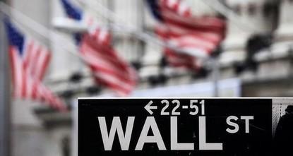 Wall Street dips on weak earnings
