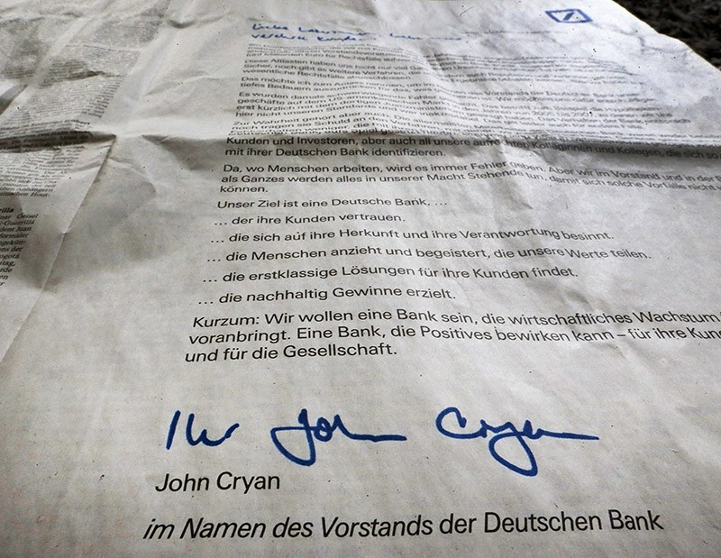 An apology for the bank's misbehaviours signed by the CEO of Deutsche Bank John Cryan is published as a newspaper ad in a big German paper in Frankfurt, Germany, Saturday, Feb. 4, 2017. (AP Photo)