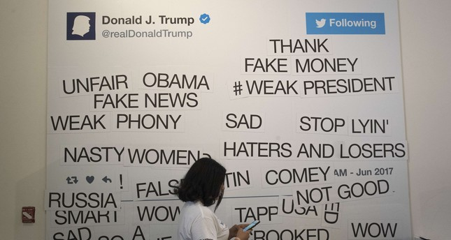 Guests can create their own tweets on a magnetic wall at The Daily Show-produced 'Donald J. Trump Presidential Twitter Library,' June 16, 2017 in New York City.