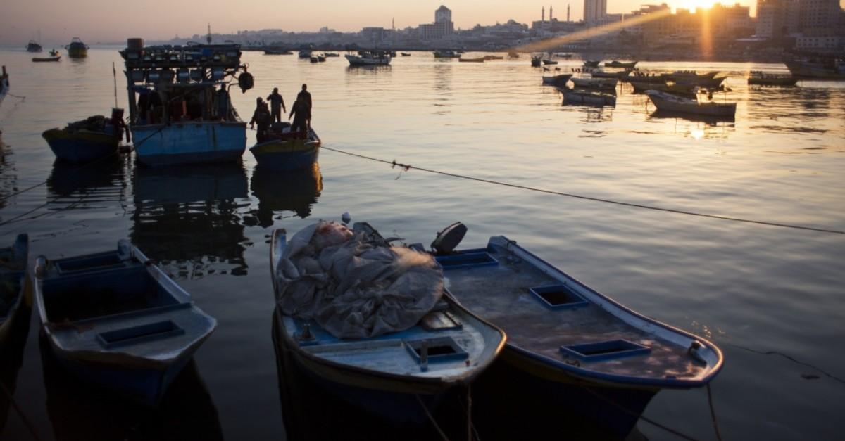 Palestinian fishermen arrive at the Gaza seaport, April 3, 2019.
