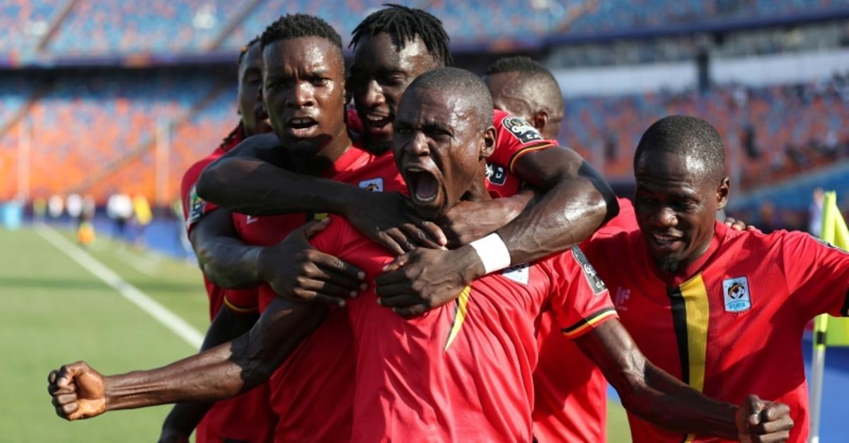Uganda's Patrick Kaddu celebrates scoring their first goal with team mates. (REUTERS Photo)