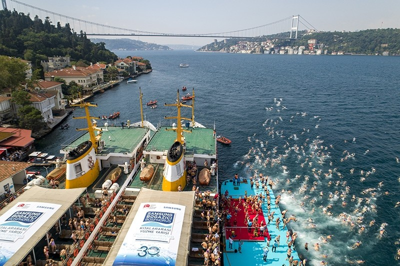 Athletes cross Istanbul's Bosporus in world's only transcontinental swimming race