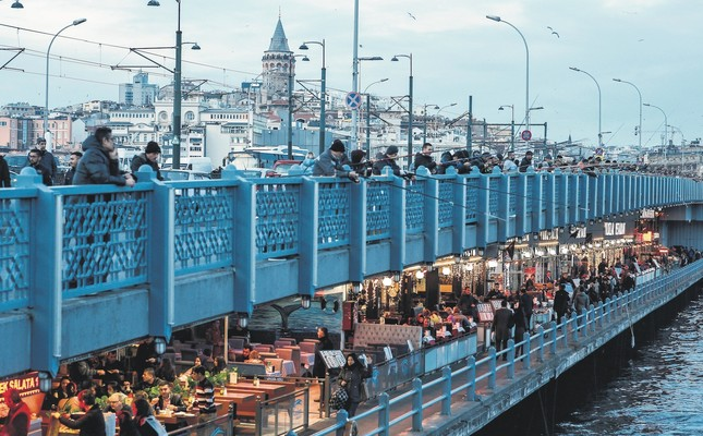 People on the Galata Bridge over Istanbul's Golden Horn. The city is the most crowded place in Turkey and has a population of over 14 million people.