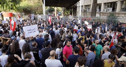 Anger prevails as Lebanese protesters surround state institutions