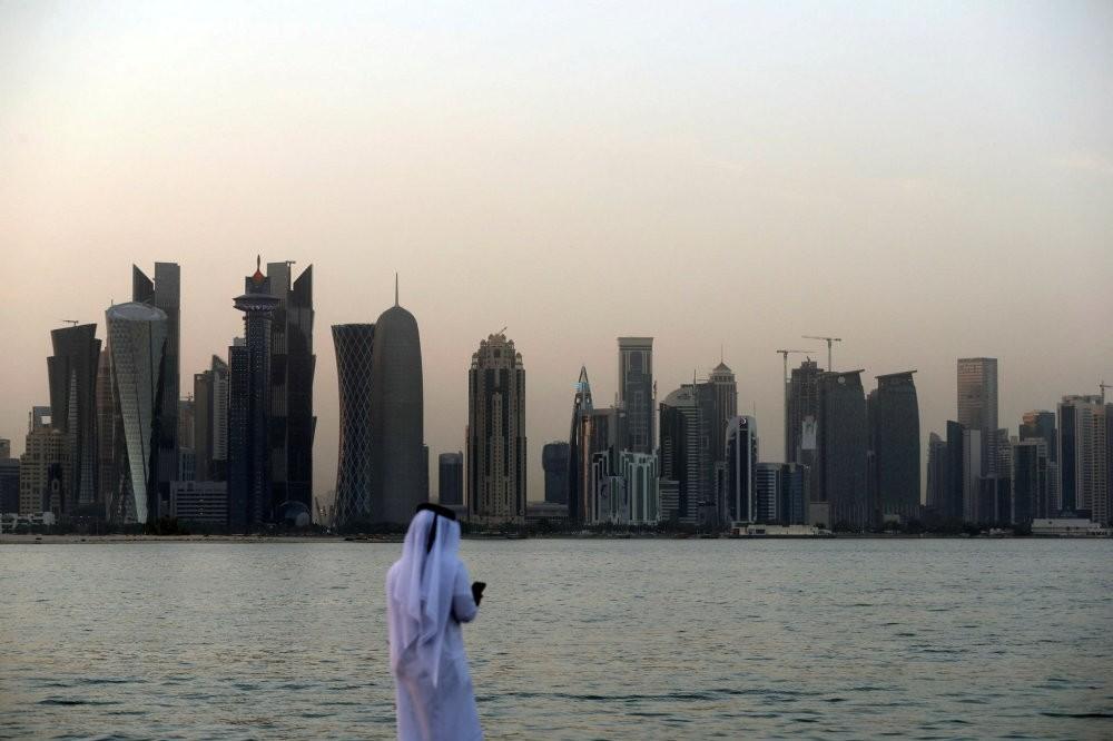 A man looks at his phone in the Qatari capital Doha, July 2.
