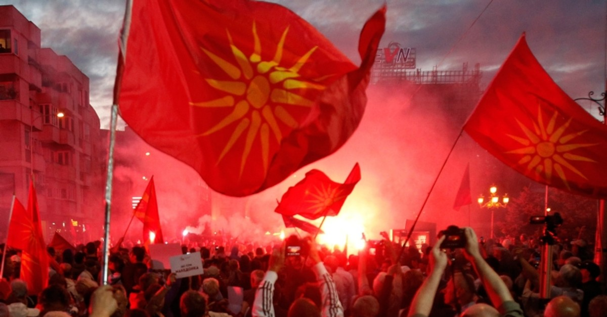 In this file photo dated Saturday, june 23, 2018, opponents of the deal between Greece and Macedonia, on changing the country's new name to ,North Macedonia,, outside the parliament in Skopje, Macedonia. (AP Photo)