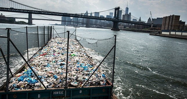 A barge with more than 300 tons of mainly plastic is on its way from the Bronx to a recycling plant in Brooklyn, New York, USA, May 26, 2016. (AP Photo)