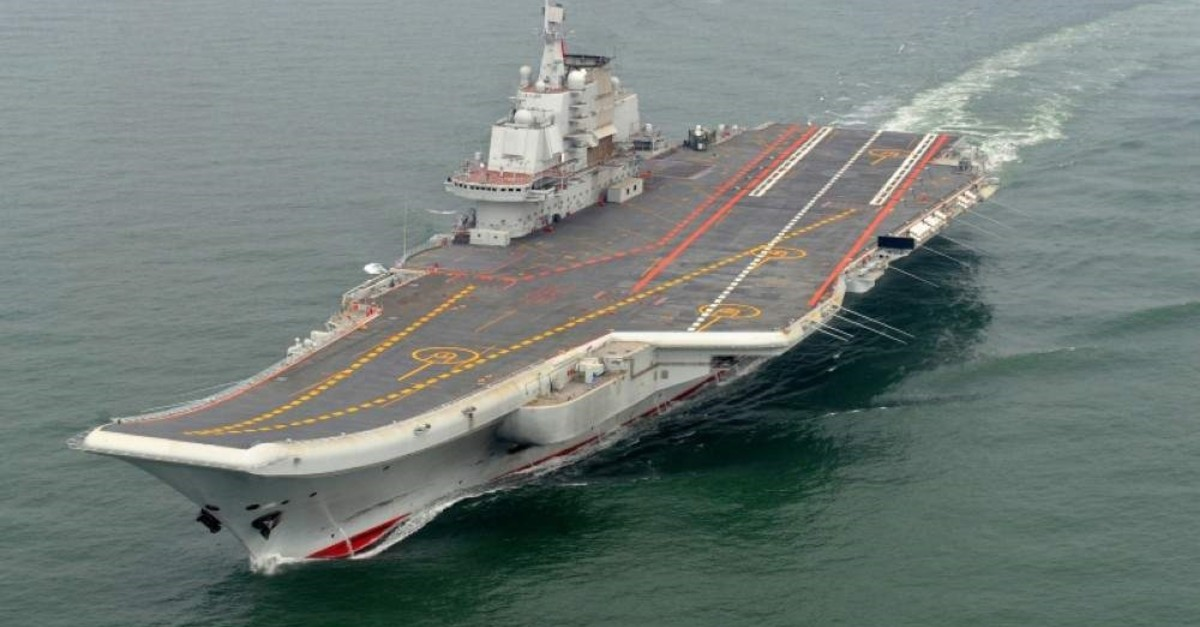 Chinau2019s first aircraft carrier u2014 the Liaoning, above, cruises for a test in the sea in 2012. (AP Photo)