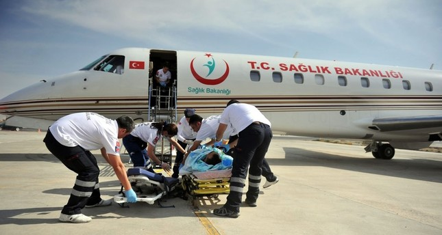 Paramedics carry a patient to an air ambulance of the Health Ministry in this undated photo.