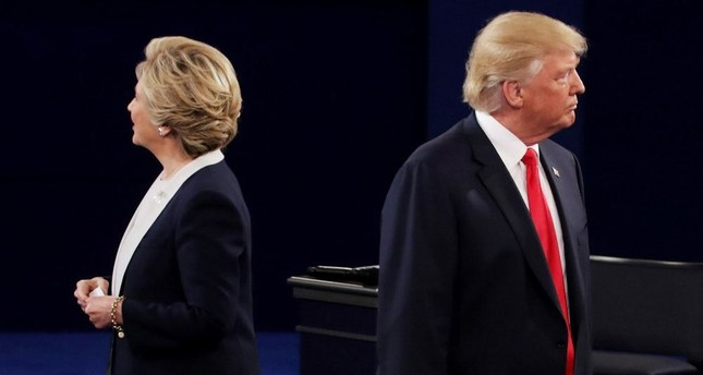 Democratic presidential nominee former Secretary of State Hillary Clinton and Republican presidential nominee Donald Trump at Washington University on Oct. 9, in St. Louis, Missouri.