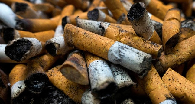 n this file photo taken on April 18, 2016 smoked cigarettes are seen in an ashtray in Centreville, Virginia (AFP Photo)
