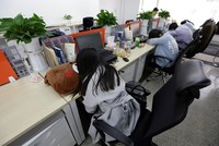 Japanese firms encourage workers to take nap breaks to fight epidemic of sleep deprivation