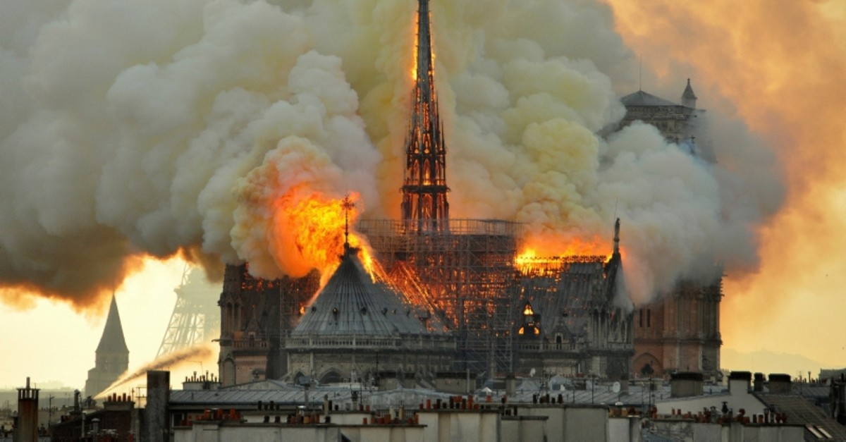 In this image made available on Tuesday April 16, 2019 flames and smoke rise from the blaze at Notre Dame cathedral in Paris, Monday, April 15, 2019. (AP Photo)