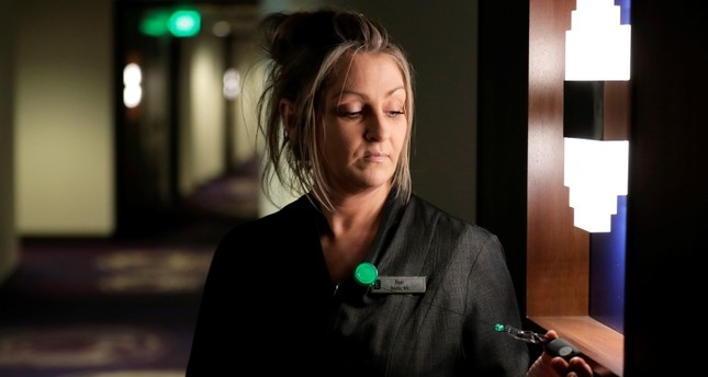 In this Wednesday, Sept. 5, 2018, photo Rani Accettola, a housekeeper at the Embassy Suites by Hilton hotel in Seattle's Pioneer Square neighborhood, poses for a photo in Seattle. (AP Photo)