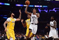 Leonard leads Clippers to overtake Lakers 111-106