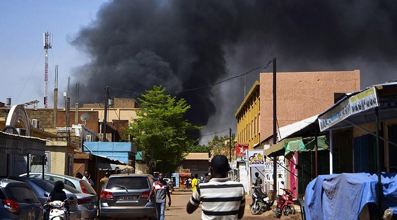 Smoke rises in the streets amidst a terrorist attack in the capital Ouagadougou, Burkina Faso. (EPA Photo)