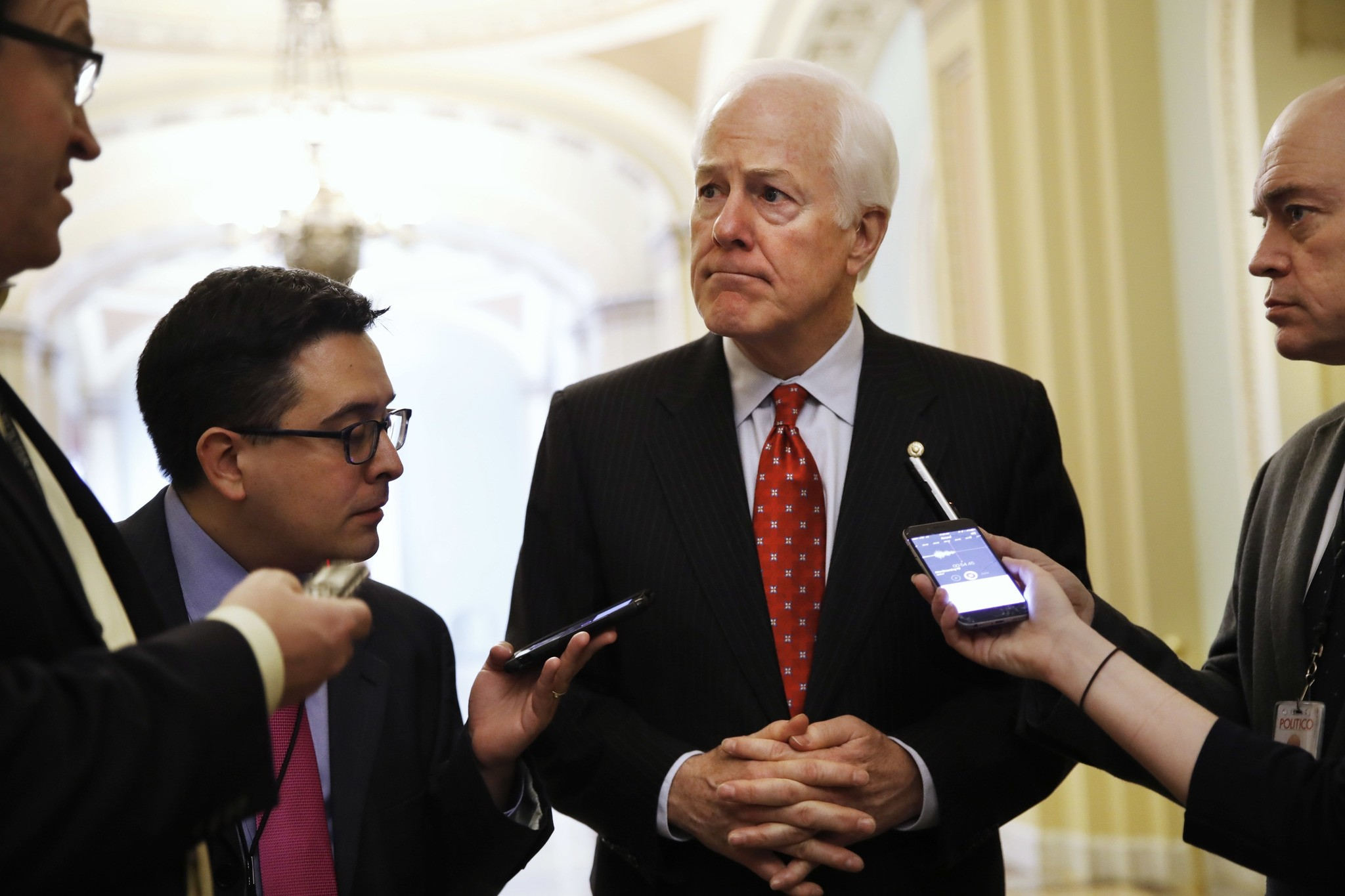 Senate Majority Whip John Cornyn of Texas talks with reporters on Capitol Hill in Washington. (AP Photo)