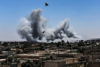 At least 18 civilians killed in US-led air strike in Syria's Raqqa, monitor says