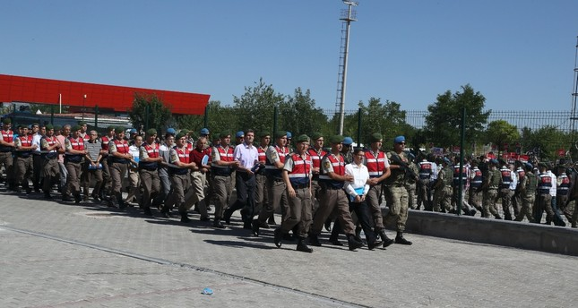 Sodliers escort defendants to the courthouse in Ankara for the takeover of Akıncı air base trial in the first hearing of the case last year.
