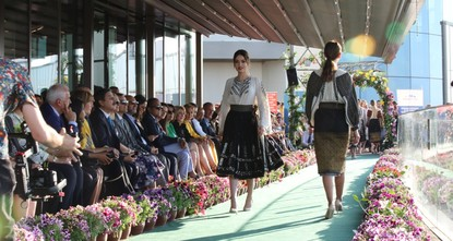 Traditional Romanian attire on runway for Syrian children