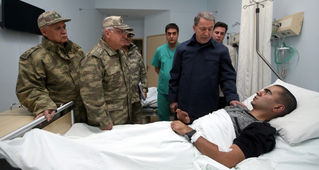 Defense Minister Hulusi Akar (L), Chief of the General Staff Gen. Yaşar Güler (C) and Turkish Land Forces Commander Gen. Ümit Dündar, visit a wounded soldier at the state hospital in Yüksekova district, Hakkari, SE Turkey, Nov. 10, 2018. (AA Photo)