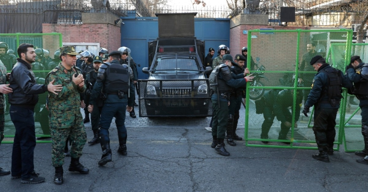 Police guard the British Embassy during an anti-UK protest in Tehran, Iran, Sunday, Jan. 12, 2020. (AP Photo)