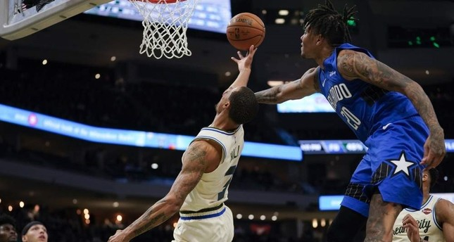 Orlando Magic's Markelle Fultz fouls Milwaukee Bucks' George Hill as he shoots during the second half of the game, Milwaukee, Dec. 9, 2019. AP Photo