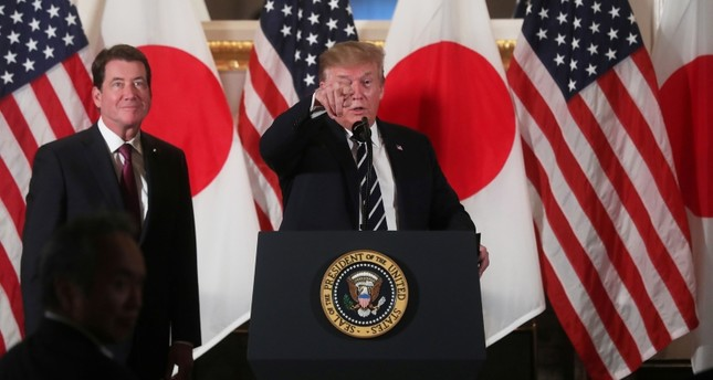 Trump begins ceremonial visit to Japan, pokes at trade