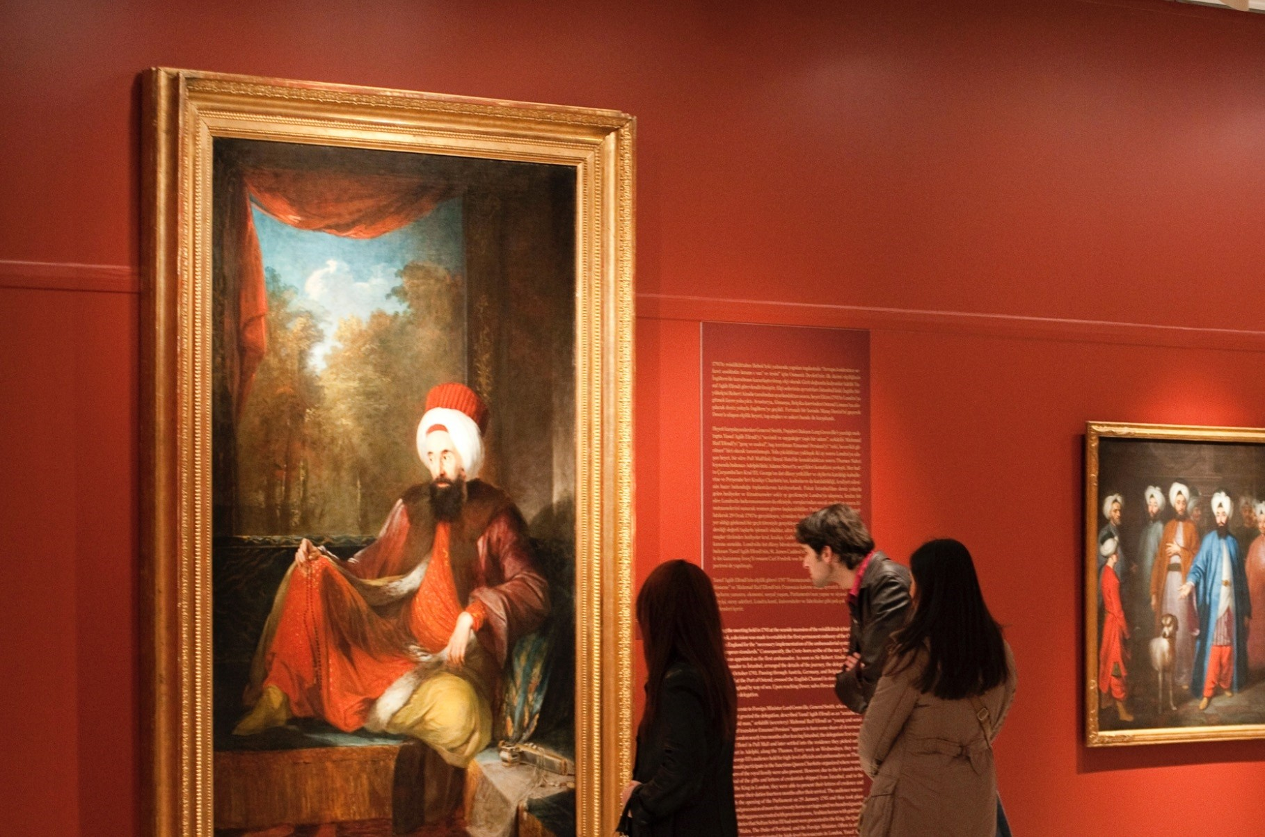 Visitors watching Pera Museumu2019s u201cIntersecting Worldsu201d collection.