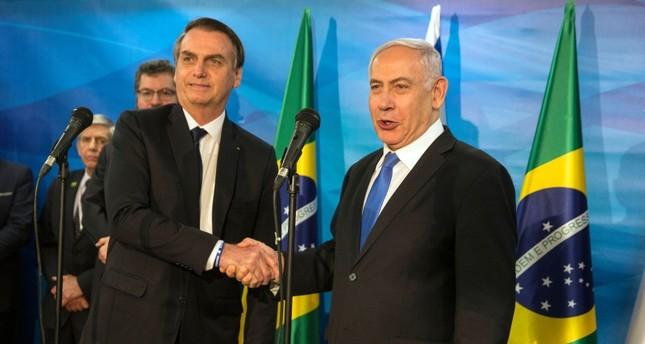 نتنياهو مستقبلا الرئيس البرازيلي يائير بولسونارو (رويترز)