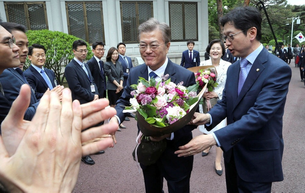 South Korean President Moon Jae-in, center, is greeted by officials upon his arrival at presidential Blue House in Seoul, Wednesday, May 10, 2017. (AP Photo)
