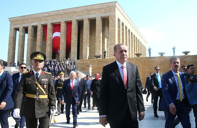 President Recep Tayyip Erdoğan, accompanied by top government officials, leaves Anıtkabir, the mausoleum of Republic's founder Mustafa Kemal Atatürk, after the Victory Day ceremony, on Aug. 30, in Ankara. AA Photo