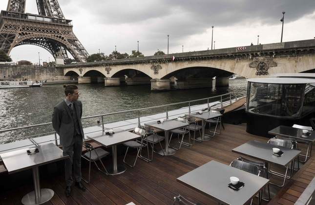 A waiter stands at French chef Alain Ducasse's new boat restaurant, the Ducasse sur Seine.