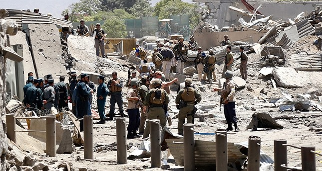 Afghan security officials inspect the scene of a suicide bomb attack in Kabul, Afghanistan, 31 May 2017. (EPA Photo)