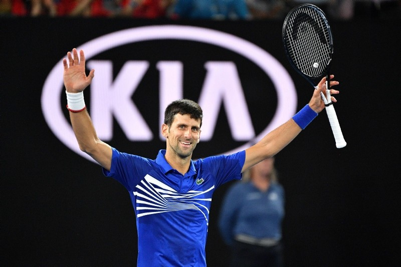 Serbia's Novak Djokovic celebrates his victory against Spain's Rafael Nadal during the men's singles final on day 14 of the Australian Open tennis tournament in Melbourne on January 27, 2019. (AFP Photo)