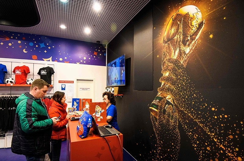 Shoppers pay for their purchases at the first official FIFA World Cup 2018 merchandise store which opened recently at the Central Childrenu2019s Store in Moscow on December 18, 2017. (AFP Photo)