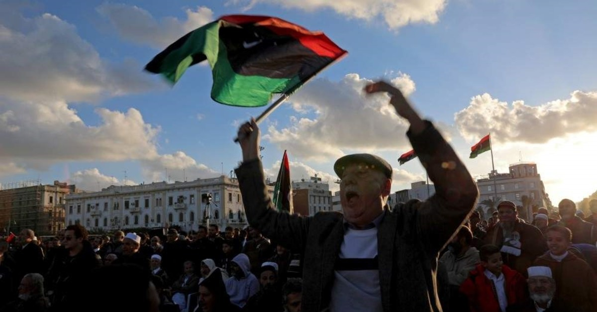 Libyan protesters shout slogans during a demonstration to demand an end to Khalifa Haftar's offensive against Tripoli, in Martyrs' Square in central Tripoli, Libya, Dec. 27, 2019. REUTERS