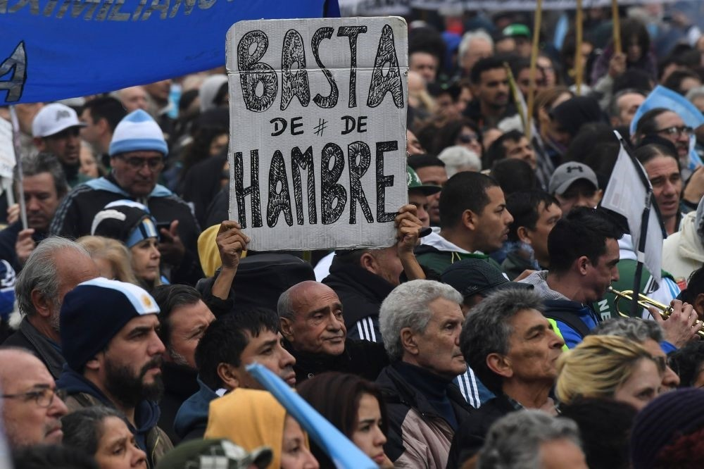 A protester holds a placard reading ,No More Hunger, during a demonstration against the government of Argentine President Mauricio Macri.