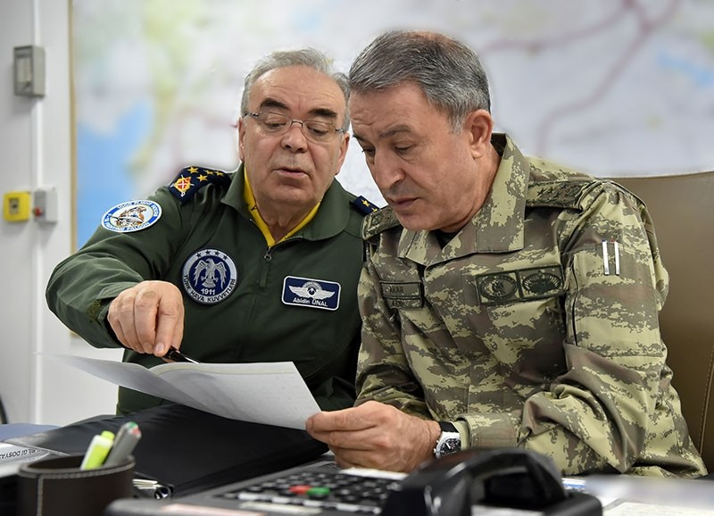 Turkish Chief of the General Staff Gen. Hulusi Akar (R) and Air Force Commander Gen. Abidin u00dcnal assess the results of the airstrike in the situation room in General Staff headquarters in Ankara, April 25, 2017. (Photo: Turkish Armed Forces)