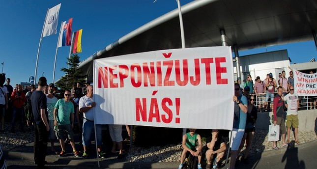 Volkswagen Slovakia employees attend a strike in demand of higher wages in Devinska Nova Ves near Bratislava, Slovakia, June 20. The banner reads: Do not humiliate us.