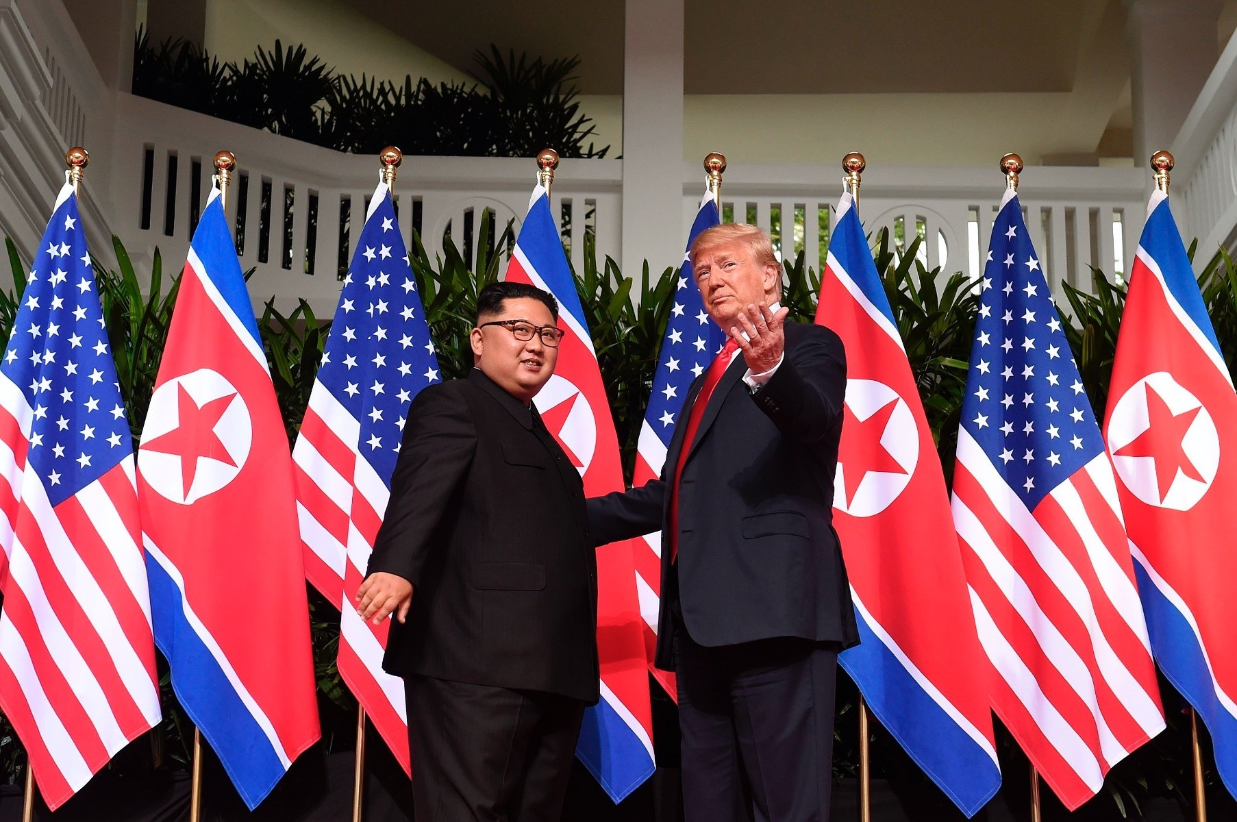 President Trump gestures as he meets with North Korea's Kim Jong Un at the start of their historic summit, Singapore, June 12.