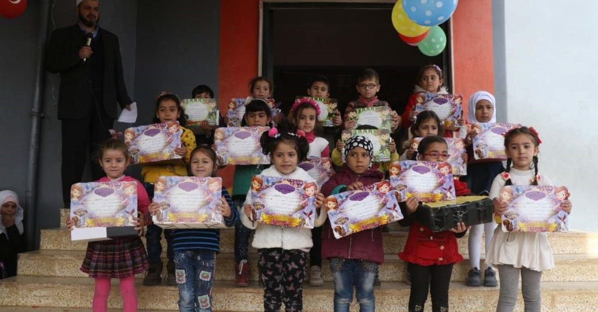 Following the event to boost morale, 186 students with successful grades were given honorary certificates and prizes, Idlib, Nov. 27, 2019. (AA Photo)